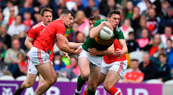 David Moran of Kerry in action against Nathan Walsh and Ian Maguire of Cork
