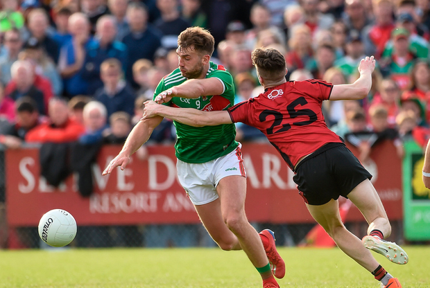 Aidan O'Shea of Mayo in action against Owen McCabe of Down