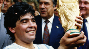 Diego Maradona raises the World Cup trophy in 1986. Photo: Getty Images