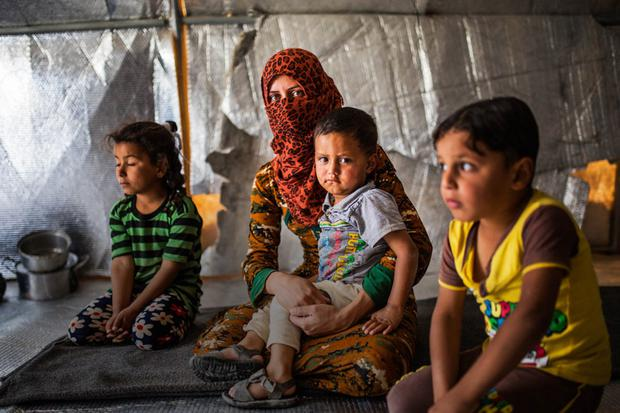 'Maybe I deserve this. But do not punish my children': Family members of Isil militants are held all together in different camps throughout Iraq