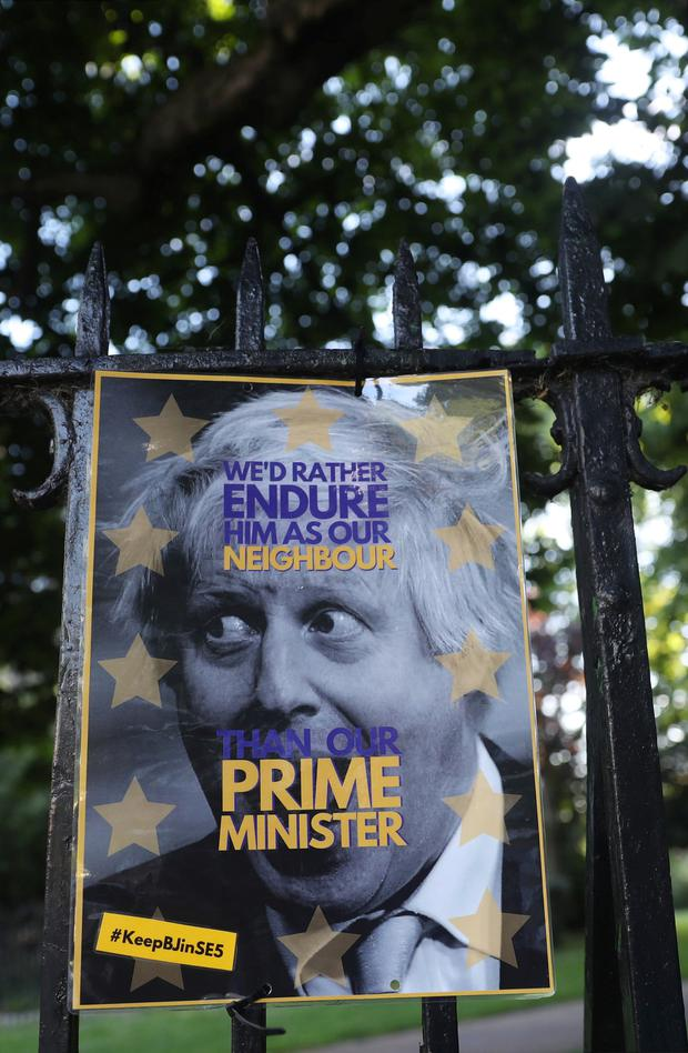 Friends and neighbours: A poster of Boris Johnson hangs on the fence opposite to his house in London. Photo: REUTERS/Simon Dawson