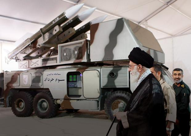 Conflict: Iran's Supreme Leader Ayatollah Ali Khamenei with a Khordad 3 missile system, the sort which is said to had been used to shoot down the US military drone, according to news agency Fars, in this undated handout picture. Photo: Fars news/Handout