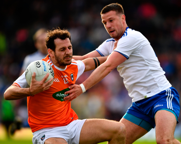 Armagh's Rian O'Neill is tackled by Monaghan's Ryan Wylie. Photo: Sportsfile
