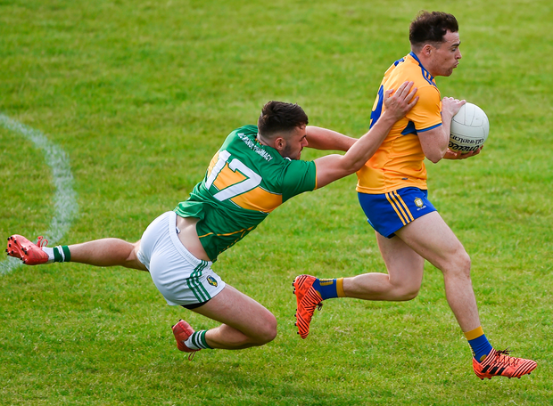 Clare's Éimhín Courtney in action against Leitrim's Oisín Madden. Photo: Sportsfile