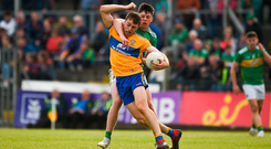 Cillian Brennan of Clare in action against Pearce Dolan of Leitrim. Photo by Daire Brennan/Sportsfile