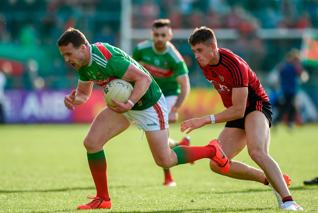 Andy Moran of Mayo in action against Pat Havern of Down. Photo by Oliver McVeigh/Sportsfile