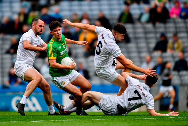 Jason Scully of Meath in action against Kildare players Mark Grace, left, Omar Dunne, 5, and Owen Whelan. Photo by Ray McManus/Sportsfile