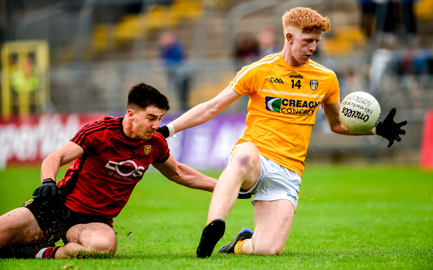Pat Shivers of Antrim in action against Ruairi McCrickard of Down. Photo by Oliver McVeigh/Sportsfile