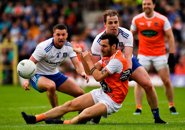 Jamie Clarke of Armagh is tackled by Ryan Wylie, left, and Conor Boyle of Monaghan. Photo by Ray McManus/Sportsfile