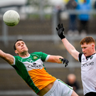 Offaly forward Niall McNamee makes a flying leap to get to the ball ahead of Sligo's Peter Laffey. Photo by Harry Murphy/Sportsfile