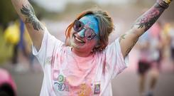 Dash of paint: Shannon Devlin, from Clondalkin, at the Irish Cancer Society's Colour Dash in Dublin's Phoenix Park. Photo: Andres Poveda