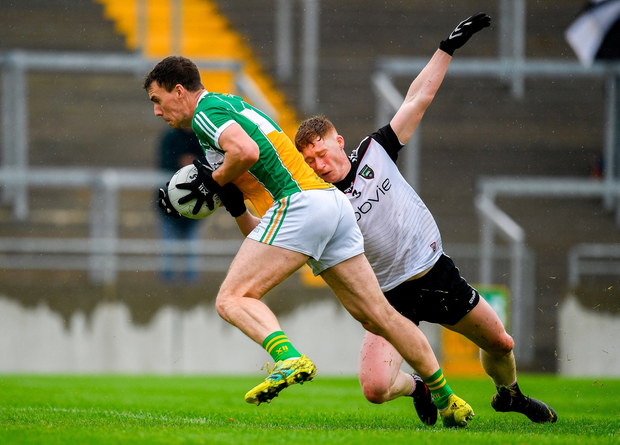 Niall McNamee of Offaly in action against Peter Laffey of Sligo. Photo by Harry Murphy/Sportsfile