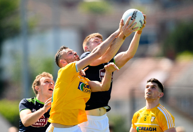 Matthew Fitzpatrick of Antrim in action against Kevin Feely of Kildare. Photo by Ramsey Cardy/Sportsfile