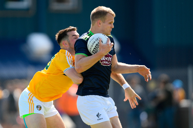 Peter Kelly of Kildare in action against Conor Murray of Antrim. Photo by Ramsey Cardy/Sportsfile