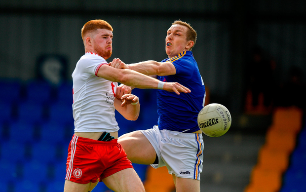 Cathal McShane of Tyrone scores his side's second goal of the game despite the attention of Patrick Fox of Longford. Photo by Eóin Noonan/Sportsfile