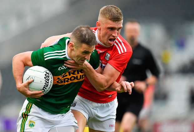 Stephen O'Brien of Kerry is tackled by Sean White of Cork. Photo by Brendan Moran/Sportsfile