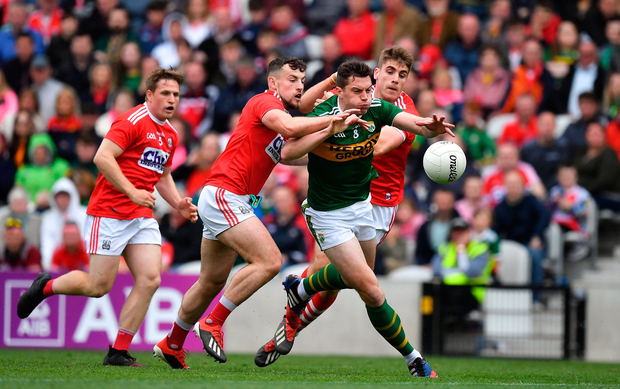 In the hunt: Kerry's David Moran feels the squeeze as Cork duo Nathan Walsh and Ian Maguire compete for the ball during Saturday's Munster SFC final. Photo by Brendan Moran/Sportsfile