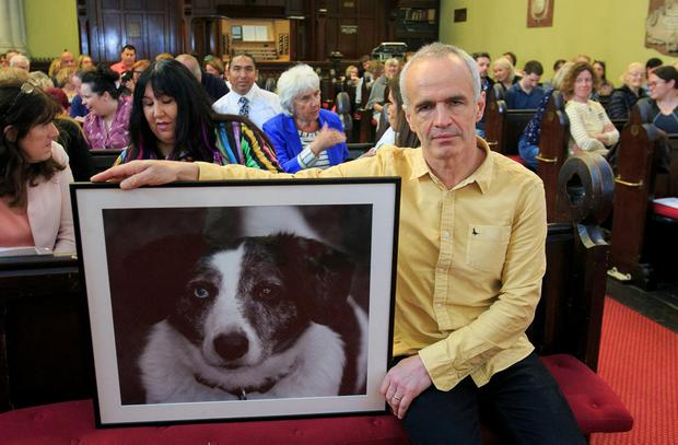 Vet Pete Wedderburn with a photo of his dog Spot. Photo: Gareth Chaney, Collins