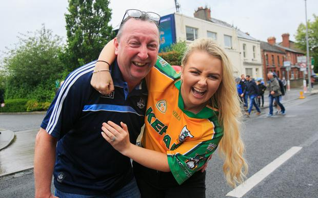 Fan fun: Billy McEvoy and daughter Sinead had divided loyalties. Photo: Gareth Chaney, Collins
