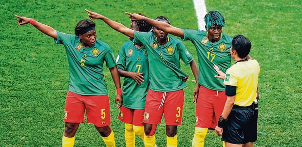 Cameroon players appeal for VAR against an offside call. Photo: John Walton/PA Wire
