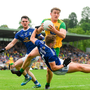 Rough 'n' tumble: Hugh McFadden of Donegal retains possession despite the attentions of Cavan pair Conor Rehill (left) and Padraig Faulkner. Photo by Ramsey Cardy/Sportsfile