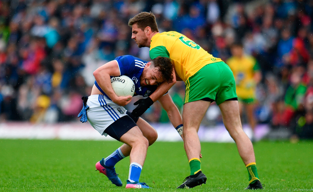 Conor Moynagh of Cavan in action against Daire Ó Baoill of Donegal. Photo by Sam Barnes/Sportsfile