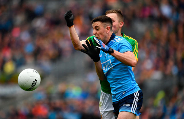 Cormac Costello of Dublinis tackled by Conor McGill of Meath. Photo by Ray McManus/Sportsfile