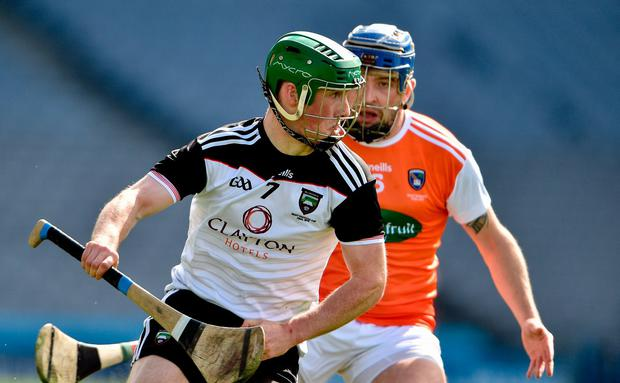 Rory McHugh of Sligo in action against Davy Bridges of Armagh. Photo: Matt Browne/Sportsfile