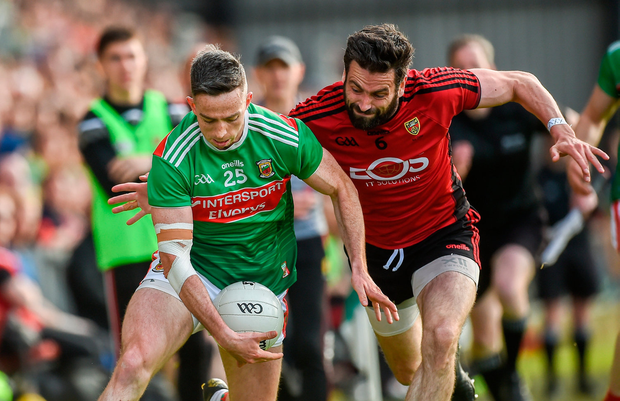 CLOSING IN: Mayo's Evan Regan is challenged by Down's Kevin McKernan during the All-Ireland SFC Round 2 qualifier at Páirc Esler in Newry, Down on Saturday. Photo by Oliver McVeigh/Sportsfile