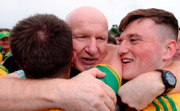 Donegal manager Declan Bonner celebrates with Niall O'Donnell, right, after their Ulster GAA Football Senior Championship Final victory against Cavan in Clones. Photo: Sam Barnes/Sportsfile