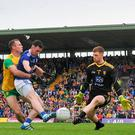 Donegal's Shaun Patton blocks an effort by Cavan's Conor Rehill during Saturday's Ulster SFC final. Photo: Sam Barnes/Sportsfile