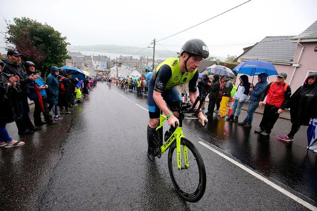 Bryan McCrystal battles the elements on the bike section of Sunday's Ironman triathlon in Youghal, Co Cork. Photo: Nigel Roddis/Getty Images for IRONMAN