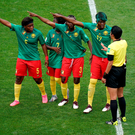 Cameroon players appeal to match referee Qin Liang after England's second goal was given by VAR after an offside call. Photo: John Walton/PA Wire