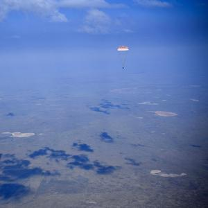 A Russian Soyuz MS-11 space capsule descends about 150 kilometers (90 miles) south-east of the Kazakh town of Zhezkazgan, Kazakhstan on Tuesday.