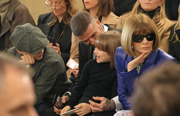 (L to R) Romeo Beckham,David Beckham, Harper Beckham and Dame Anna Wintour attend the Victoria Beckham show during London Fashion Week February 2019 at Tate Britain on February 17, 2019 in London, England. (Photo by David M. Benett/Dave Benett/Getty Images)