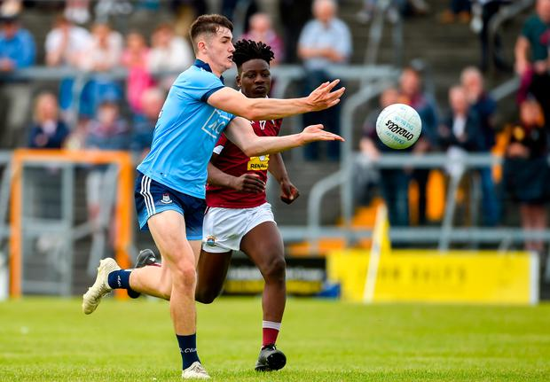 Luke Swan of Dublin in action against Darren Mnguni of Westmeath during the Electric Ireland Leinster MFC semi-final match at TEG Cusack Park in Mullingar, last Saturday. Photo: Diarmuid Greene/Sportsfile