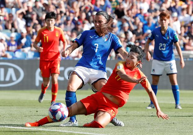 China's Shuang Wang in action with Italy's Alia Guagni during the Women's World Cup last 16 clash in Montpellier, France. Photo: REUTERS/Jean-Paul Pelissier