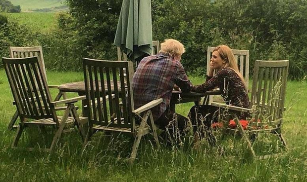 'This picture, which you have surely seen on multiple occasions by now, is of Boris Johnson and his girlfriend Carrie Symonds. It mysteriously manifested on Monday, three days after the British media was convulsed by reports that police were called to Symonds' London flat because of a loud exchange between her and Johnson'