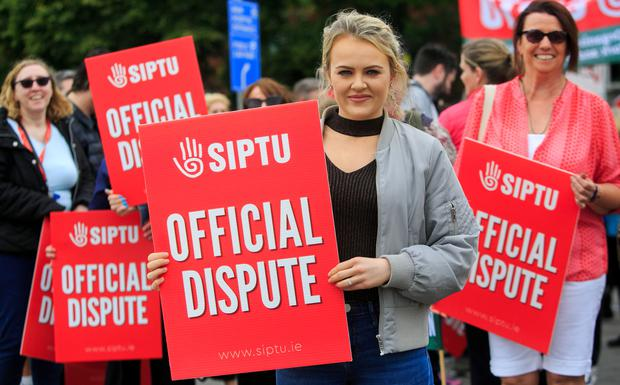 Health support staff Stacey Moody from Tallaght during strike action at St James's Hosptial in Dublin' City Centre Photo: Gareth Chaney Collins