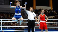 Jumping for joy: Michaela Walsh celebrates beating Germany's Ornella Warner in the featherweight quarter-final. Photo: PA