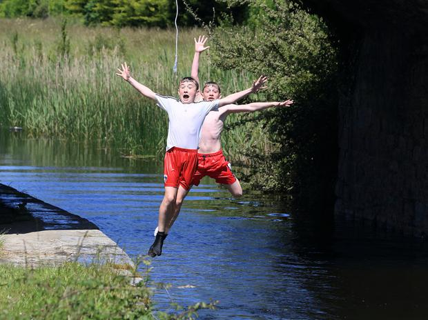 Brandon Fitzgerald (12) and Aaron Houlihan (13) from Athy jump into the Grand Canal in the Co Kildare town. photos: Frank McGrath