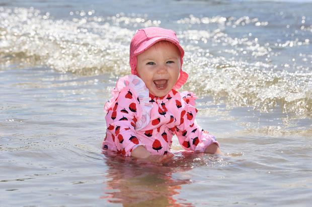 Mini heatwave: Kate O'Doherty (1) from Kildare enjoys her first experience of the sea at Sandycove in Co Dublin. photos: Frank McGrath