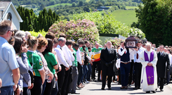 The remains of Manus Kelly are carried from St Columba's Church in Glenswilly in Donegal. Photos: Steve Humphreys
