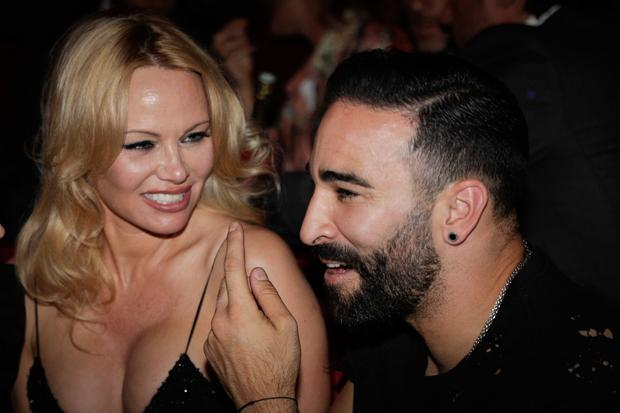 US actress Pamela Anderson (L) and Marseille's French defender Adil Rami (R) attend the Premiere of the new show