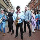 Miami Showband saxophonist Des Lee with (L to R) Chris Mohan as Dickie Rock, writer Martin Lynch, Freshmen frontman Derek Dean, Aileen Mythen as Foles Mother and Gavin Peden as Bap, Mick, Peter and new Miami member. Photo Leon Farrell/Photocall Ireland.