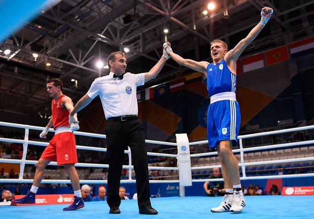 Ireland's Kurt Walker, right, celebrates following victory in his men's Bantamweight semi-final bout against Peter McGrail of Great Britain at the 2019 European Games in Minsk, Belarus. Photo: Seb Daly/Sportsfile