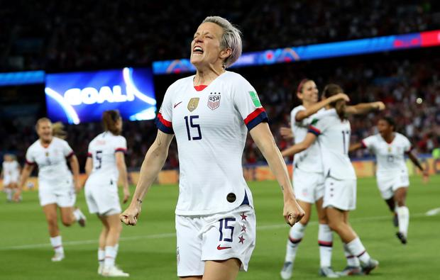 United States' Megan Rapinoe, center, celebrates after scoring her side's second goal in the Women's World Cup quarter-final soccer match against France at the Parc des Princes. (AP Photo/Francisco Seco)