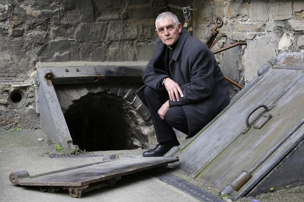 Saddened: David Pierpoint, Archdeacon of Dublin, beside the entrance to one of the crypts in St Michan's Church. Photo: Damien Eagers / INM