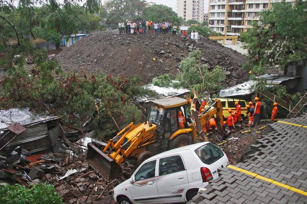 Rescue workers look for survivors among the debris of a collapsed wall of a residential complex in Pune, India, June 29, 2019. REUTERS/Stringer