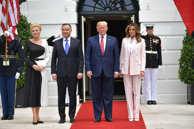 US President Donald Trump and First Lady Melania Trump greet Poland's President Andrzej Duda and his wife Agata Kornhauser-Duda at the South Portico of the White House in Washington, DC on June 12, 2019. (Photo by MANDEL NGAN / AFP)